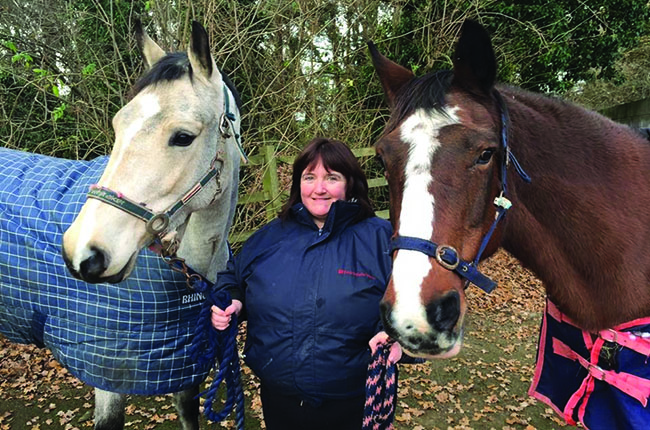 Wendy Furness with two horses