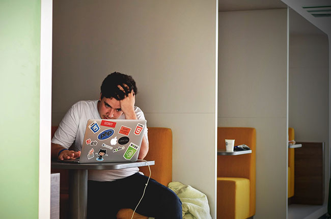 Student looking stressed at laptop